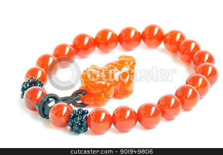 Red beads stock photo, Glass prayer beads on a white background by John Young
