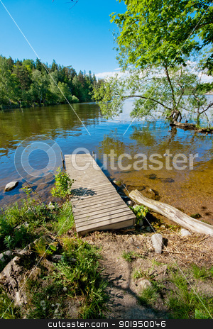 Jetty in water stock photo, A jetty lying in the water on a sunny summer day by Tommy Alsén