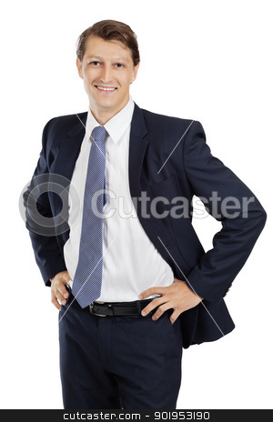 Happy young attractive businessman stock photo, Photo of an attractive young businessman with hands on his hips and looking at the camera. by © Ron Sumners