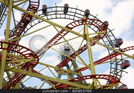 Roller coaster and large ferris wheel in Prater, Vienna, Austria stock photo, Roller coaster and large ferris wheel in Prater, Vienna, Austria by vladacanon1