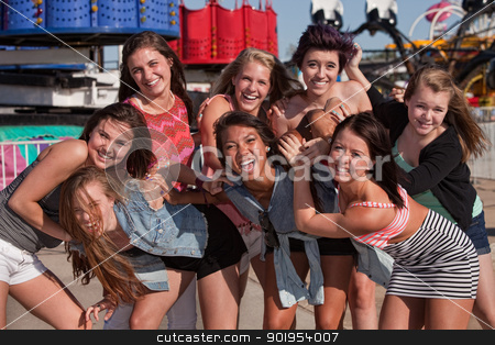 Stylish Group of Teens at a Carnival stock photo, Group of 8 happy female teens together at a carnival by Scott Griessel