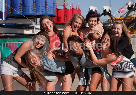Group of Giggling Teenage Girls stock photo, Giggling group of teenage girls at a theme park by Scott Griessel