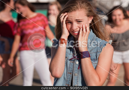 Teenagers Laughing at Scared Girl stock photo, Mixed group of young girls outside together by Scott Griessel