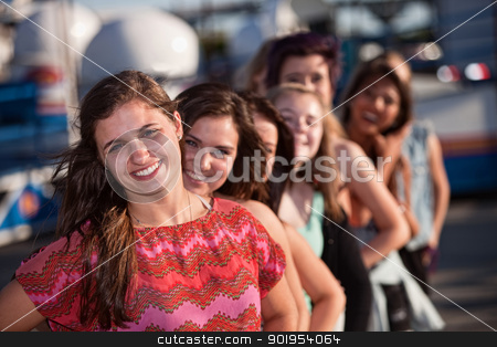 Confident Teen with Girlfriends stock photo, Confident female teenager with group of friends outdoors by Scott Griessel