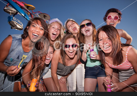 Happy Girls at Carnival with Bubbles stock photo, Group of happy girls with bubbles at amusement park by Scott Griessel