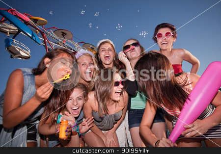 Group of Laughing Teen Girls stock photo, Group of eight female teenagers blowing bubbles together by Scott Griessel