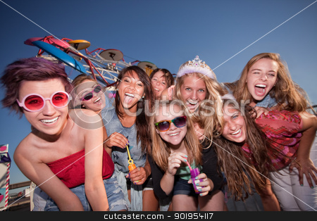 Cute Teen Girls Blowing Bubbles stock photo, Mixed group of young girls outside blowing bubbles by Scott Griessel