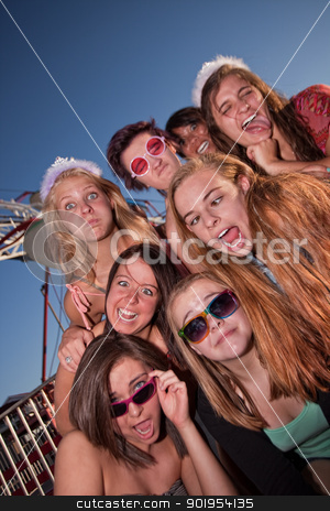 Girls Outside Making Faces stock photo, Mixed group of young girls outside making faces by Scott Griessel