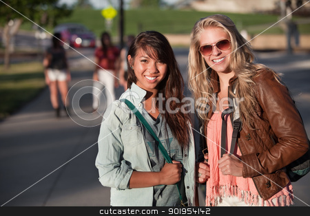 Two Young Students Outdoors stock photo, Two smiling teenage female students on school campus by Scott Griessel