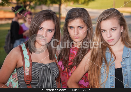 Tough Girls Outside stock photo, Trio of tough stylish teenage female students hanging out  by Scott Griessel