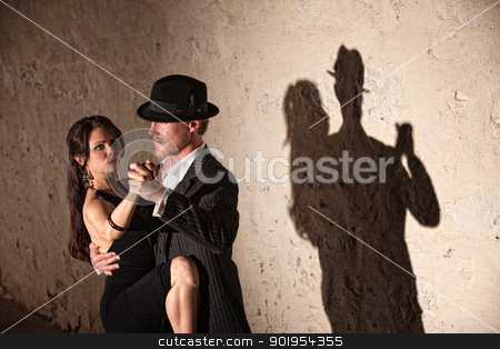 Tango Dancers Under Spotlight stock photo, Attractive tango dancers under spotlight in urban setting by Scott Griessel