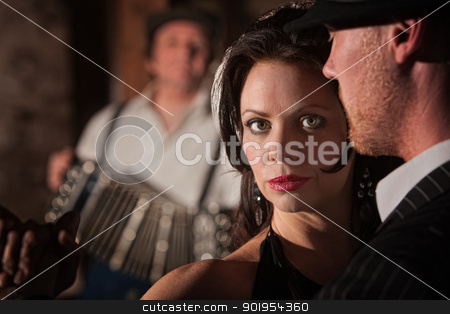 Beautiful Tango Dancer with Partner stock photo, Beautiful tango dancer with partner and accordion musician by Scott Griessel