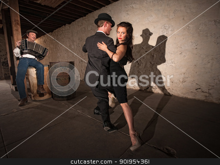 Rustic Urban Tango Dancers stock photo, Bellows musician with Tango dancers in spotlight by Scott Griessel