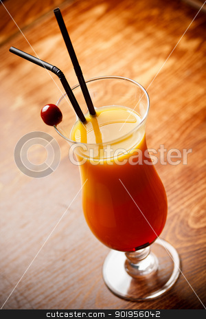 Cocktail with orange Juice  stock photo, Cocktail with orange Juice on bar tabel, cherry and straw decoration by Grafvision