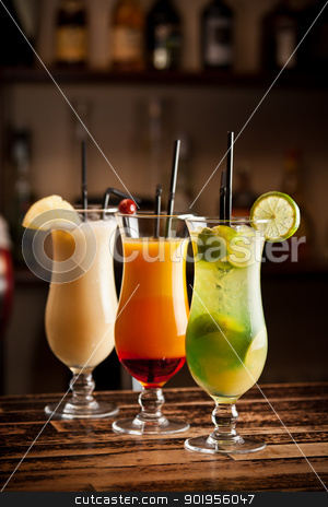 Three fresh cocktails stock photo, Three fresh cocktails on a bar table  by Grafvision