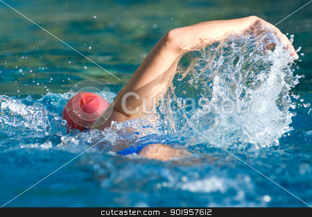 Swimmer stock photo, Athletic swimmer in action in a swimming pool by Picturehunter