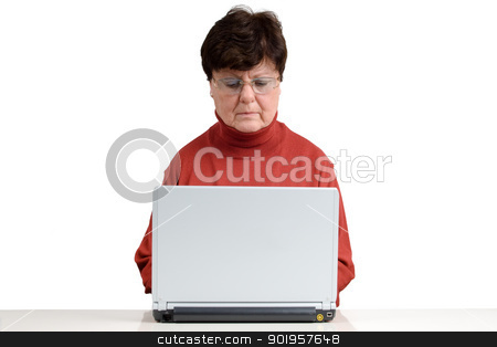 Senior woman with a notebook stock photo, Senior woman in front of a computer. Studio picture. Full isolated. by Picturehunter