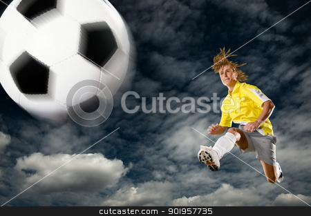 Soccer lady stock photo, Soccer playing woman shoots a ball by Picturehunter