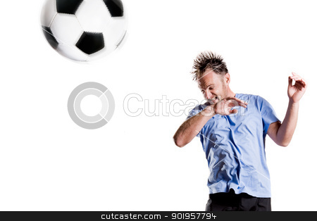 Head ball stock photo, Soccer player in action. Full isolted studio picture by Picturehunter