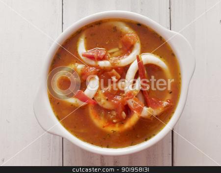 calamari seafood soup stock photo, close up of a bowl of calamari seafood soup by zkruger