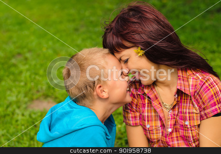 Mother and son outdoors stock photo, Mother and son play outside on field in the park by nvelichko