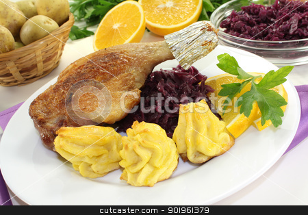 fresh Duck drumstick with duchess potatoes stock photo, fresh fried Duck drumstick with duchess potatoes and red cabbage on a light background by Maren Wischnewski