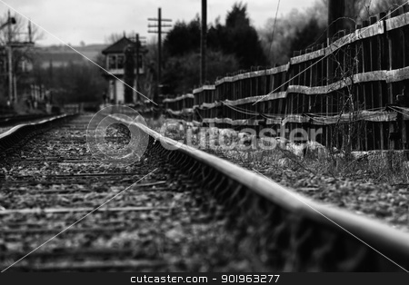Set of derelict train tracks stock photo, Black and white image of a set of derelict train tracks from the days of the steam locomotive by Joshua Hilton