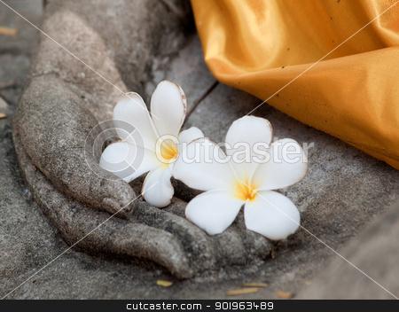plumeria flower on ancient hand of buddha statue stock photo, plumeria flower on ancient hand of buddha statue by jakgree