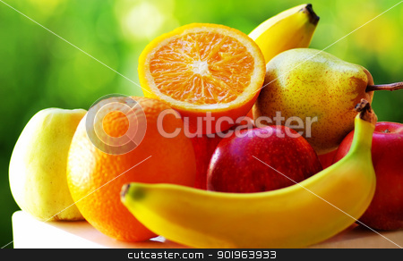 Colored fruits on table. stock photo, Colored fruits on table. by Inacio Pires