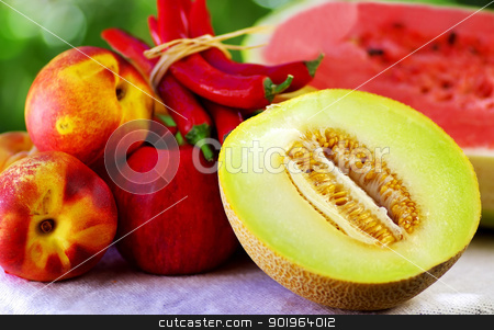 Half of melon. Chili and fruits stock photo, Half of melon. Chili and fruits by Inacio Pires