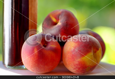 Ripe peaches and liquor stock photo, Ripe peaches and bottle of liquor by Inacio Pires