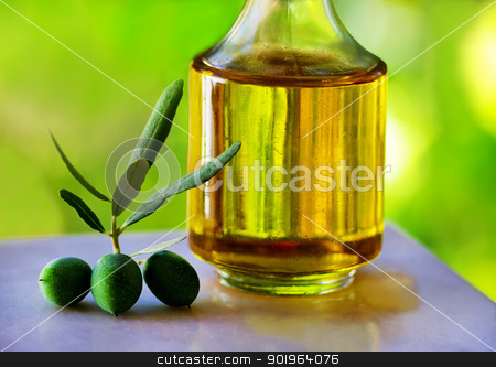 Green olives and olive oil stock photo, Green olives and olive oil by Inacio Pires