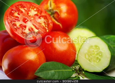 Cucumber and red tomato stock photo, Cucumber and red tomato by Inacio Pires