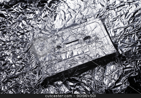 Audio stock photo, Audio compact cassette covered with aluminium foil. by Stocksnapper