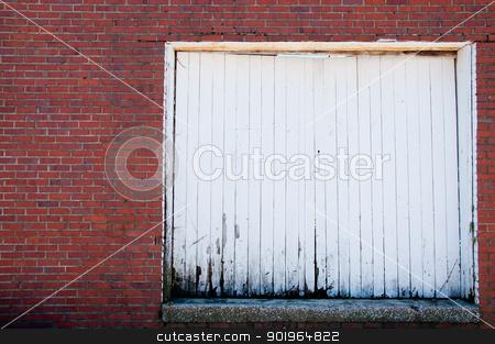 Painted Door stock photo, An old wood door of a brick warehouse. by Joe Tabb