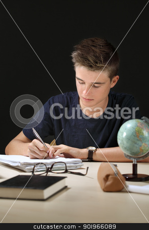 Homework stock photo, Photo of a young teenager doing his homework in a dark room.  by © Ron Sumners