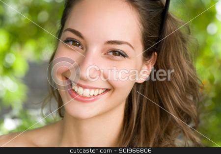 Clouseup portrait of a friendly brunette. stock photo, Clouseup portrait of a beautiful  friendly young brunette woman. by exvivo