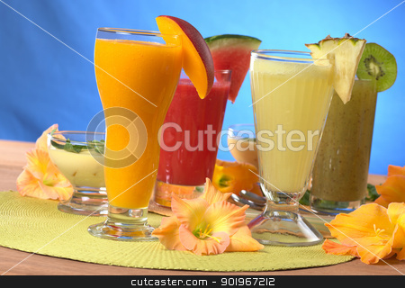 Fruit Juices stock photo, Mango, pineapple, watermelon and kiwi smoothies surrounded by gladiolus flower (Selective Focus, Focus on the mango and pineapple smoothies in the front) by Ildi Papp
