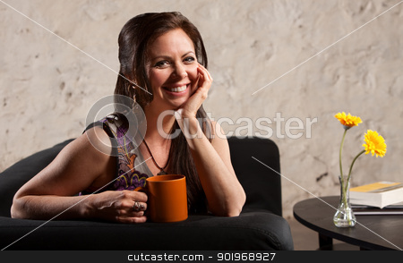 Smiling Woman with Cup stock photo, Happy Caucasian brunette female sitting indoors with cup by Scott Griessel
