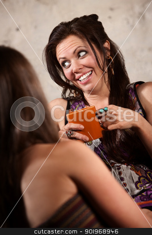 Happy Woman Talking with Friend stock photo, Laughing Caucasian brunette female sitting with friend indoors by Scott Griessel