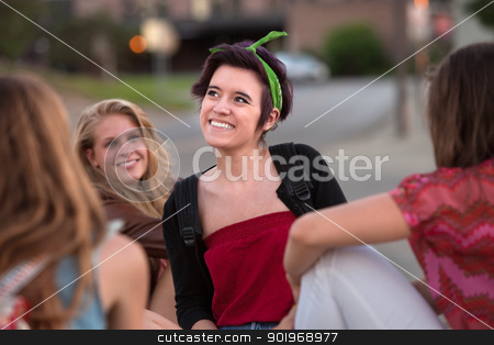 Happy Girl Looking Away stock photo, Happy Hispanic teenage girl with friends looking away by Scott Griessel