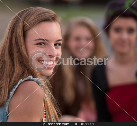 Cute Girl Looking Over Shoulder stock photo, Pretty European teenage girl with smile looking over shoulder by Scott Griessel