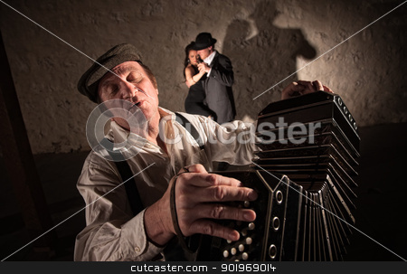 Two Dancers Near Bandoneon Player stock photo, Singing bandoneon player with two dancers in the background by Scott Griessel
