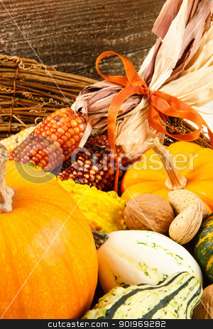 Fall Harvest Decoration With Pumpkins, Gourds And Indian Corn stock photo, Colorful autumn harvest vegetables make a colorful Fall decoration sitting in a basket against a wood background by Karen Sarraga