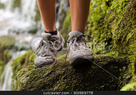 Hicking shoes in outdoor action stock photo, Closeup of hiking shoes with a stream in the background by Kamila Starzycka