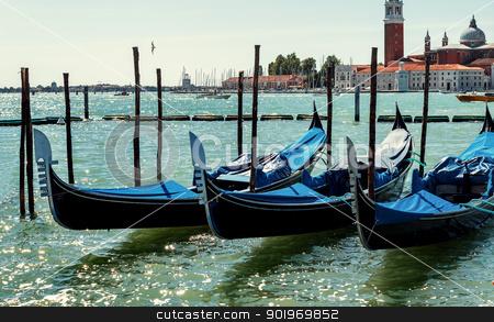 gondolas in Venice, Italy Grand canal  stock photo, empty blue gondolas in lagoon Venice Italy by Artush