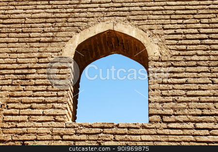 Arched Window in Brick Wall stock photo, An ancient arched window in brick wall on a background of a blue sky by Niloo