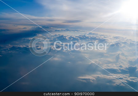 white clouds in blue sky. stock photo, blue sky background with tiny clouds. View from top by Aikon
