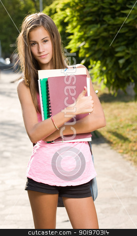 Beautiful young student girl showing thumbs up. stock photo, Half length portrait of a beautiful young student girl showing thumbs up. by exvivo