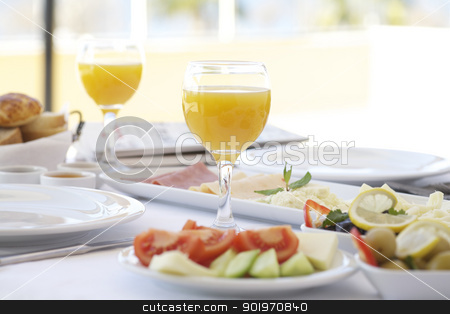 Fresh orange juice on breakfast table stock photo, Fresh orange juice on breakfast table with tomatoes, cucumber, cheeses and olives by necati turker